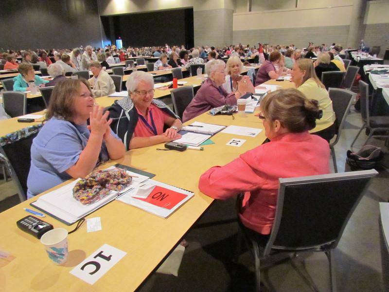Delegates participate in Bible study.