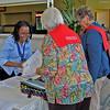 Valora Starr, Women of the ELCA staff, credentials arriving delegates.
