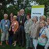 ELCA Presiding Bishop Mark Hanson poses with a group of loyal Lutherans during the opening reception, Thursday, July 14, 2011, at the Eighth Triennial Gathering of the Women of the ELCA in Spokane, Wash. <br /> JB