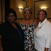 Women of the ELCA staff Ann Hightower (left) and Eva Yeo (right) pose with Leymah Gbowee (middle) on Thursday evening during the international guest reception at the Triennial Gathering. DB