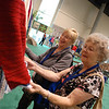 Ada Junge, Roswell, GA, and Mary Lou Fish, Marietta, GA, admire the crocheted edge on some of the prayer shawls in the exhibit area. Hundreds of shawls made by Women of the ELCA participants will be distributed to ministries and communities in the ELCA's Eastern Washington-Idaho Synod. EH
