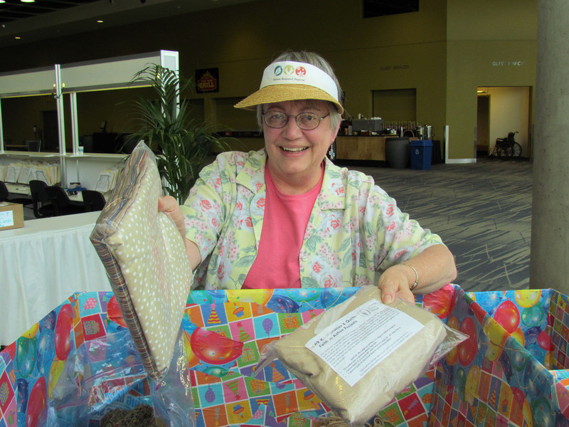 A participant makes a donation of in-kind gifts.