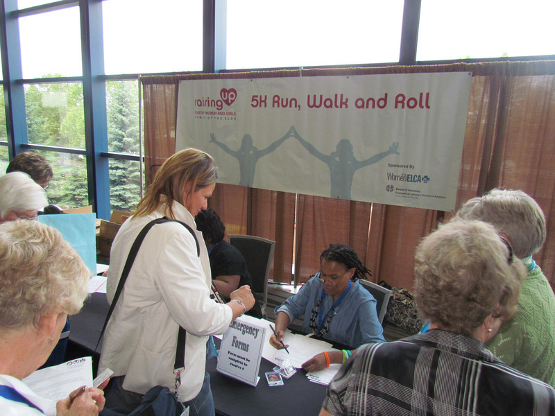 Participants sign up for the 5k Run, Walk and Roll.