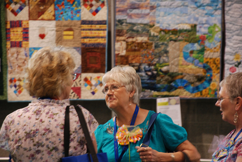 What would a gathering be without quilts? Some participants enjoy quilted artworks created to fit the 2011 triennial theme: Renew, Respond, Rejoice! EH