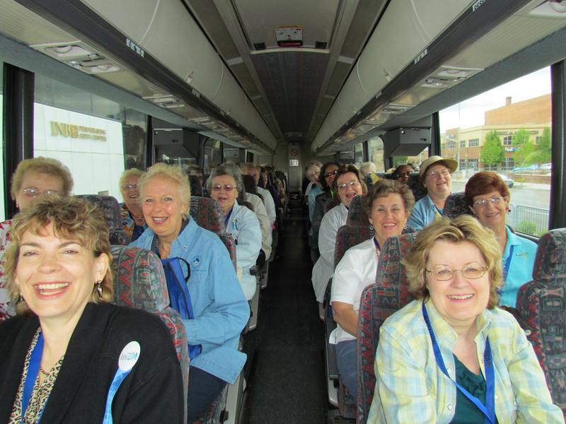 Smiling faces as participants leave for a tour.
