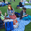 Participants relax on picnic blankets at Thursday's opening reception. EH