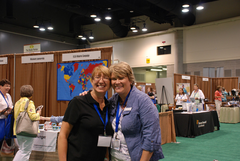 Twila Schock, director for ELCA global mission support, and Brenda Moore, a regional gift planner for the ELCA Foundation, pose in the exhibit area.
