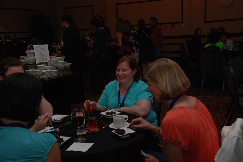 Emily Colman, Burke, Va., and Kelly Frohner, San Clemente, Calif., chat with other Chocolate Loungers at a Thursday evening meet-and-greet. EH