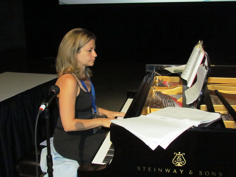 Emily Hansen, Women of the ELCA staff, plays piano at the conventions service of Holy Communion.