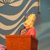 Bold Mamma (a.k.a. Charlene Spillmann) delivers announcements.