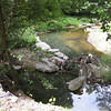 "After a season of intense rains, a line of boulders placed to redefine the meander of Joseph's Branch may not be lovely to behold, but more importantly the reconstructed bank is still functioning.<br /> <br /> The Montgomery County Department of Environmental Protection (DEP) received a $2 million TE grant in 2000 to construct channel restoration and habitat improvements in Rock Creek Park. In an effort to restore and protect the Rock Creek watershed, which ultimately drains to the Chesapeake Bay, this project added modern stormwater controls to 730 acres to the Turkey Branch Stream subwatershed (approx. 30% of the drainage area). The project including work along 12,000 feet of the Turkey Branch Stream, along 13,400 feet of the Sycamore Creek, and along Joseph's Branch Stream. The Rock Creek watershed drains approximately 60 square miles.<br /> <br /> You can learn more about the DEP's work in this watershed by visiting their website at: <a href=""http://www.montgomerycountymd.gov/deptmpl.asp?url=/content/dep/restoration/home.asp"">http://www.montgomerycountymd.gov/deptmpl.asp?url=/content/dep/restoration/home.asp</a>"