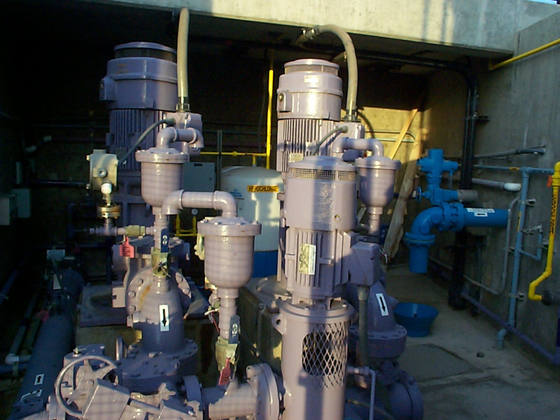 <b>Pumps seen in the photo circulate the recycled water in a distribution system, where it is sold for irrigation and indoor flushing applications to local clients, including a nearby cemetery and park, and city and commercial buildings. Revenue from water is approximately $100,000, which helps offset the $250,000 annual maintenance cost for the SMURRF.</b>  The Santa Monica Urban Runoff Recycling Facility (SMURRF) treats and reuses dry-weather runoff from parts of western Los Angeles City and of central Santa Monica City before this source of pollution can reach Santa Monica Bay. Over 100 million gallons of urban runoff drain from Los Angeles County into the ocean on a typical dry weather day. This flow includes runoff from landscaping irrigation, car washes, hosing down of hardscapes, pool draining and other highly contaminated sources. It is the primary source of pollution into the bay, affecting beach users and aquatic life alike. SMURRF helps mitigate this pollution by treating up to 500,000 gallons daily and recycling the water for irrigation and indoor flushing purposes. In addition, the SMURRF blends technology, art, and education to create an international example of innovative urban ecological management.