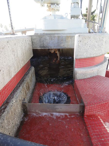 <b>The Grit Chamber, which separates grit (sediment) through centrifugal force of a spinning propellor seen in photo in main chamber.</b>  The Santa Monica Urban Runoff Recycling Facility (SMURRF) treats and reuses dry-weather runoff from parts of western Los Angeles City and of central Santa Monica City before this source of pollution can reach Santa Monica Bay. Over 100 million gallons of urban runoff drain from Los Angeles County into the ocean on a typical dry weather day. This flow includes runoff from landscaping irrigation, car washes, hosing down of hardscapes, pool draining and other highly contaminated sources. It is the primary source of pollution into the bay, affecting beach users and aquatic life alike. SMURRF helps mitigate this pollution by treating up to 500,000 gallons daily and recycling the water for irrigation and indoor flushing purposes. In addition, the SMURRF blends technology, art, and education to create an international example of innovative urban ecological management.