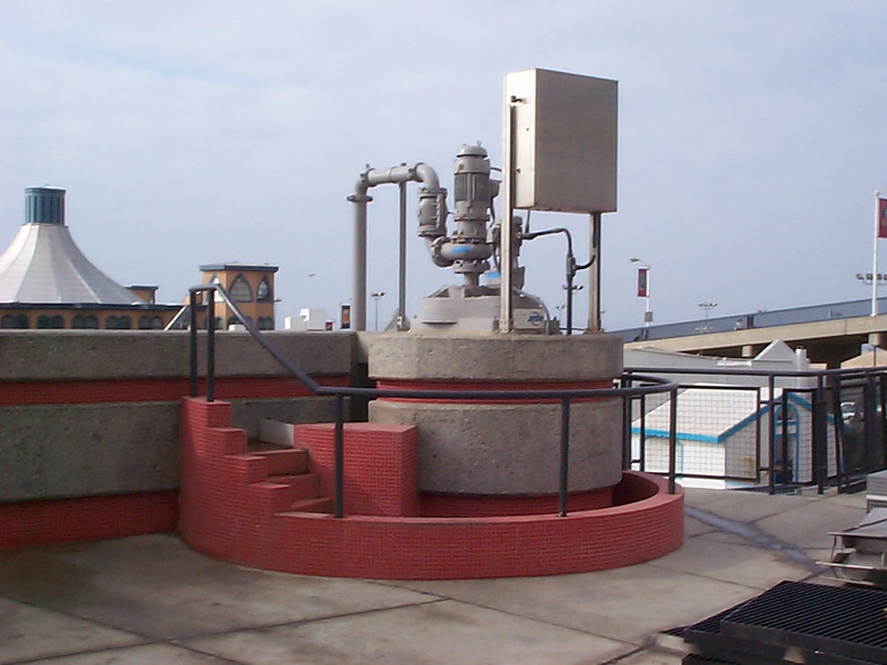 <b>The second treatment process, the Grit Chamber, to separate grit (sediment) through centrifugal force, and includes the second waterfall.</b>  The Santa Monica Urban Runoff Recycling Facility (SMURRF) treats and reuses dry-weather runoff from parts of western Los Angeles City and of central Santa Monica City before this source of pollution can reach Santa Monica Bay. Over 100 million gallons of urban runoff drain from Los Angeles County into the ocean on a typical dry weather day. This flow includes runoff from landscaping irrigation, car washes, hosing down of hardscapes, pool draining and other highly contaminated sources. It is the primary source of pollution into the bay, affecting beach users and aquatic life alike. SMURRF helps mitigate this pollution by treating up to 500,000 gallons daily and recycling the water for irrigation and indoor flushing purposes. In addition, the SMURRF blends technology, art, and education to create an international example of innovative urban ecological management.