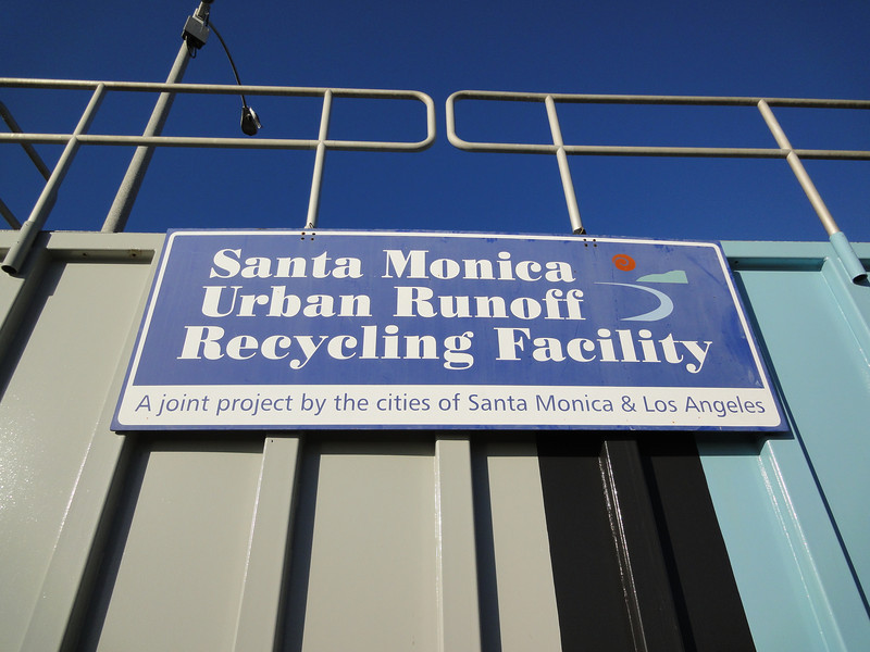 The Santa Monica Urban Runoff Recycling Facility (SMURRF) treats and reuses dry-weather runoff from parts of western Los Angeles City and of central Santa Monica City before this source of pollution can reach Santa Monica Bay. Over 100 million gallons of urban runoff drain from Los Angeles County into the ocean on a typical dry weather day. This flow includes runoff from landscaping irrigation, car washes, hosing down of hardscapes, pool draining and other highly contaminated sources. It is the primary source of pollution into the bay, affecting beach users and aquatic life alike. SMURRF helps mitigate this pollution by treating up to 500,000 gallons daily and recycling the water for irrigation and indoor flushing purposes. In addition, the SMURRF blends technology, art, and education to create an international example of innovative urban ecological management.
