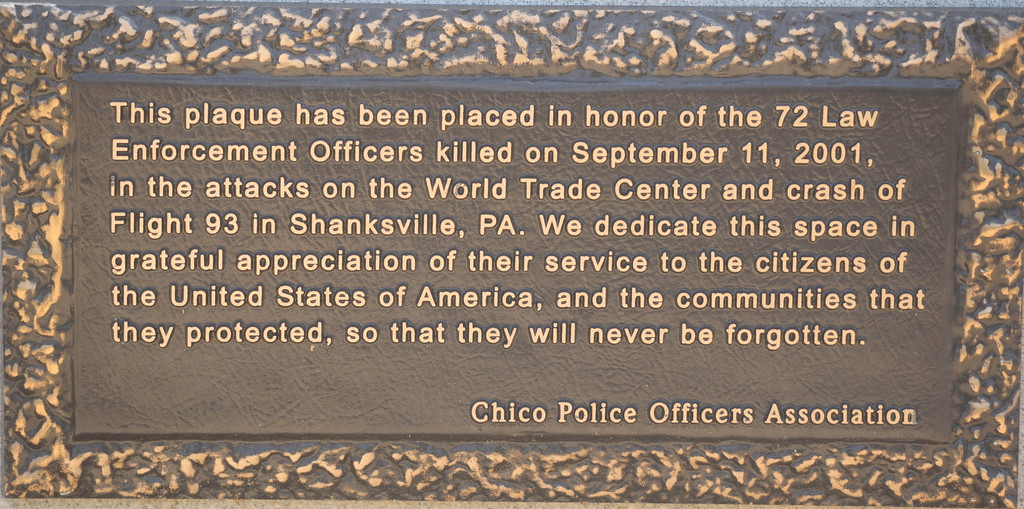 . A plaque is seen honoring the 72 Law Enforcement Officers killed on Sept. 11, 2001 during the attacks on the World Trade Center and Flight 93 in Shanksville, PA during the 9/11 memorial observance at Chico Fire Station Five on Manzanita Ave. in Chico, Calif. Monday Sept. 11, 2017. (Bill Husa -- Enterprise-Record)