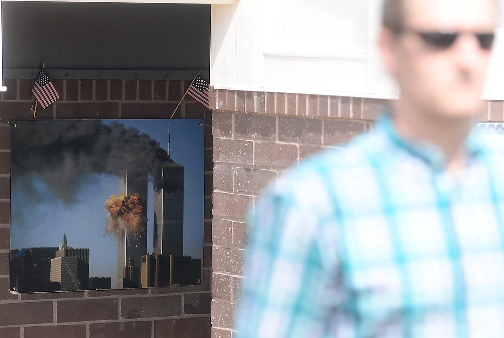 . A photo seen inside of the 9/11 memorial serves as a reminder of the events the unfolded Sept. 11, 2001 seen during the 9/11 memorial observance at Chico Fire Station Five on Manzanita Ave. in Chico, Calif. Monday Sept. 11, 2017. (Bill Husa -- Enterprise-Record)