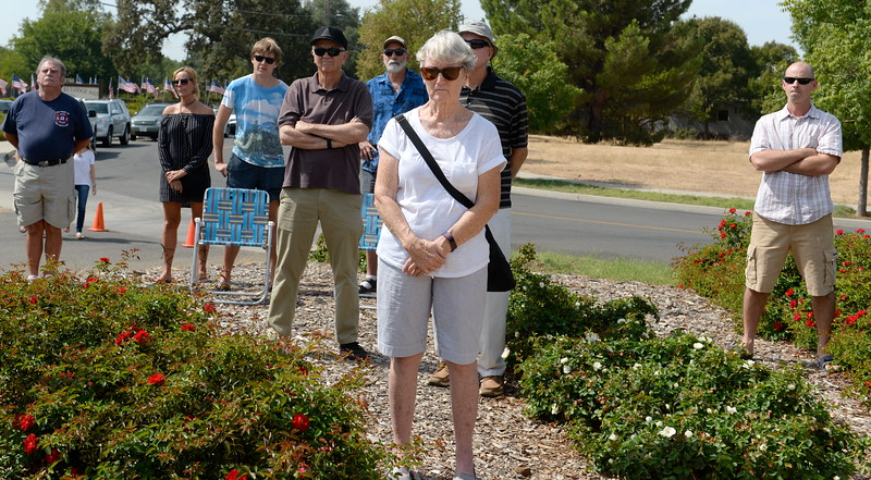 People listen as they remember the events of Sept. 11, 2001 during the 9/11 memorial observance at Chico Fire Station Five on Manzanita Ave. in Chico, Calif. Monday Sept. 11, 2017. (Bill Husa -- Enterprise-Record)
