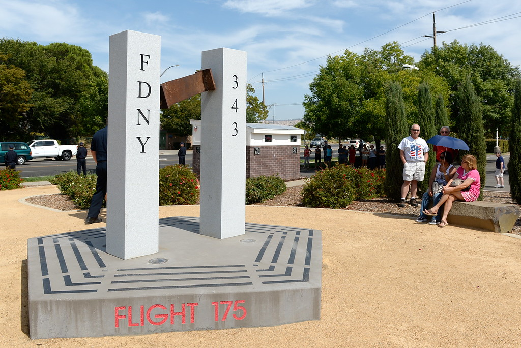 . People gather at the 9/11 memorial in observance of this day to never forget at Chico Fire Station Five on Manzanita Ave. in Chico, Calif. Monday Sept. 11, 2017. (Bill Husa -- Enterprise-Record)
