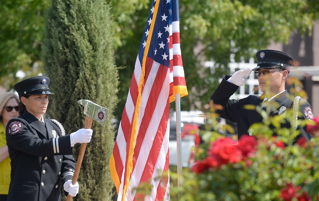 . The Color Guard brings in the flag during the 9/11 memorial observance at Chico Fire Station Five on Manzanita Ave. in Chico, Calif. Monday Sept. 11, 2017. (Bill Husa -- Enterprise-Record)