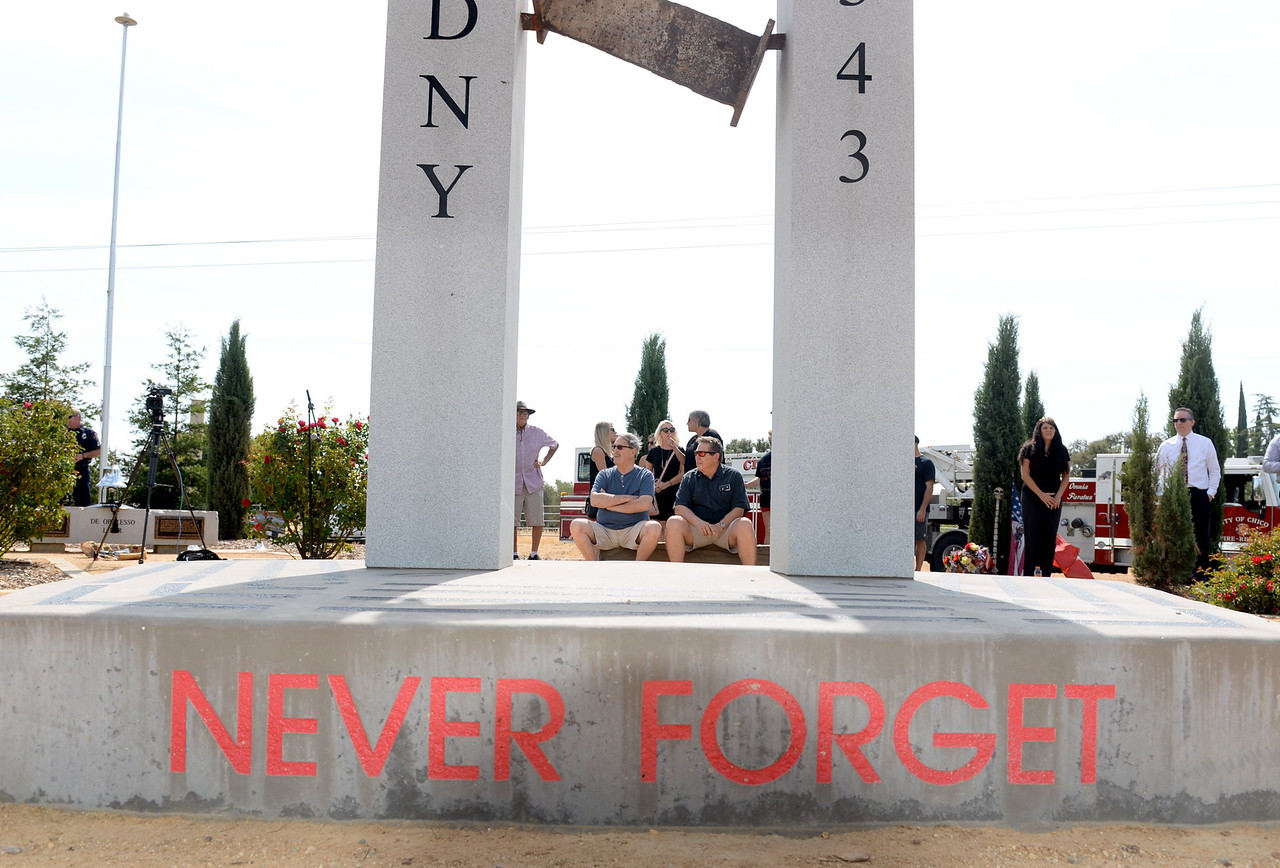 People gather at the 9/11 memorial in observance of this day to never forget at Chico Fire Station Five on Manzanita Ave. in Chico, Calif. Monday Sept. 11, 2017. (Bill Husa -- Enterprise-Record)