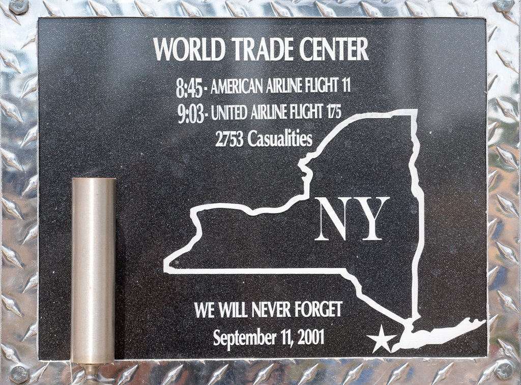 . A plaque remembering the 2753 casualties of the World Trade Center on Sept. 11, 2001 is seen during the 9/11 memorial observance at Chico Fire Station Five on Manzanita Ave. in Chico, Calif. Monday Sept. 11, 2017. (Bill Husa -- Enterprise-Record)