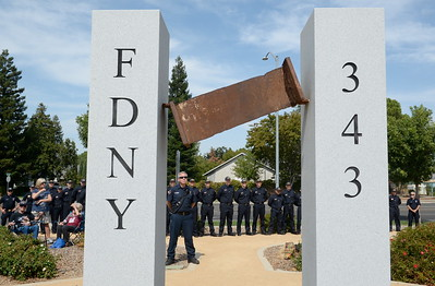 Members of the Butte College Fire Academy and Chico Fire Department surround the  9/11 memorial observance at Chico Fire Station Five on Manzanita Ave. in Chico, Calif. Monday Sept. 11, 2017. (Bill Husa -- Enterprise-Record)
