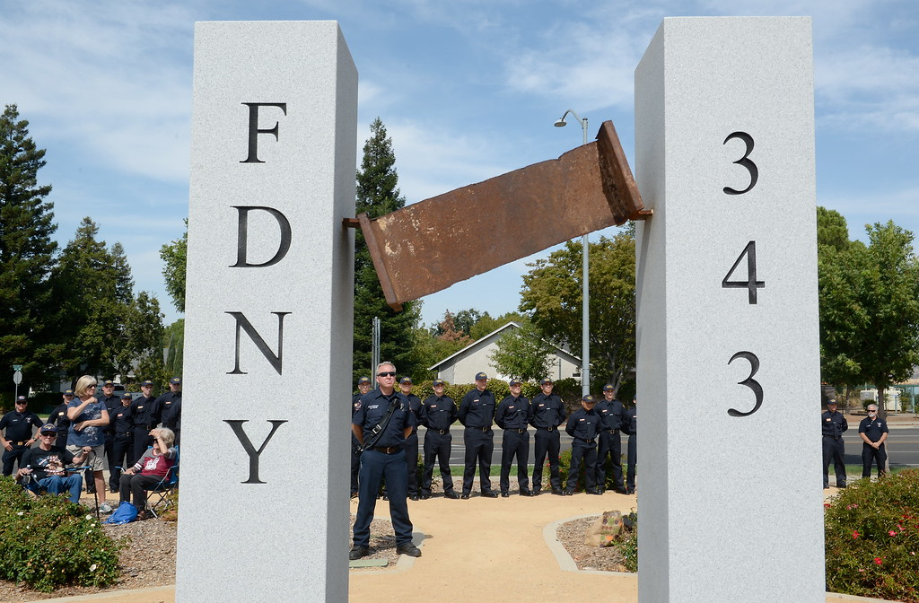 . Members of the Butte College Fire Academy and Chico Fire Department surround the  9/11 memorial observance at Chico Fire Station Five on Manzanita Ave. in Chico, Calif. Monday Sept. 11, 2017. (Bill Husa -- Enterprise-Record)