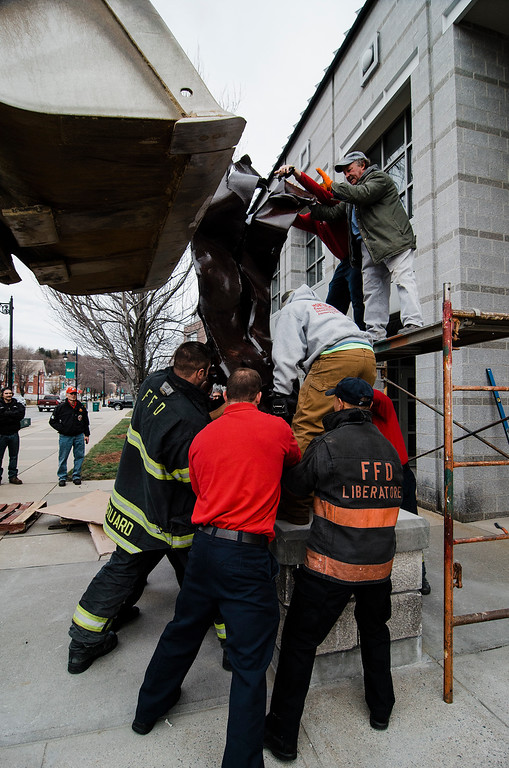 . Members of the from Fitchburg Fire Department worked to install a steel beam, a piece of the twin towers, onto it\'s base outside the department on Friday, December 8, 2017. A 9/11 memorial has been in the works since the department received the beam in 2011. SENTINEL & ENTERPRISE / Ashley Green