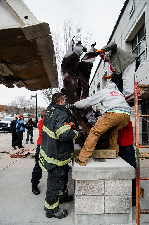 . Members of the Fitchburg Fire Department worked to install a steel beam, a piece of the twin towers, onto it\'s base outside the department on Friday, December 8, 2017. A 9/11 memorial has been in the works since the department received the beam in 2011. SENTINEL & ENTERPRISE / Ashley Green