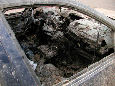 The inside of a burned out police vehicle.