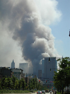 Smoke pours from Ground Zero, view from the West Side Highway, shortly after both Twin Towers collapsed.
