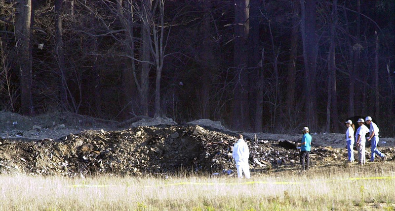 FILE - In this Tuesday, Sept. 11, 2001 file photo, emergency workers look at the crater created when United Airlines Flight 93 crashed near Shanksville, Pa. (AP Photo/Keith Srakocic)