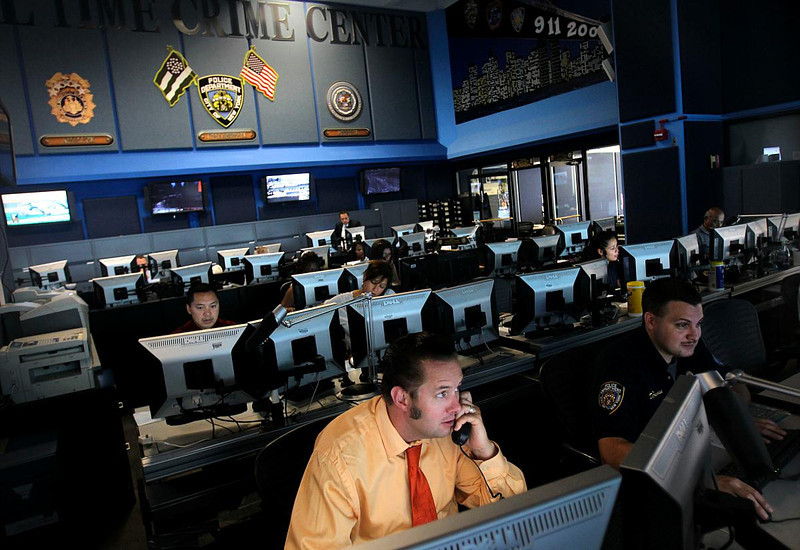 FILE In this July 22, 2010 file photo, employees work inside the Real Time Crime Center at police headquarters in New York. A decade after the Sept. 11 terror attacks, New York City emergency agencies are better trained and better equipped to communicate in a disaster, but first responders in cities around the country say the progress is not good enough. A national network is needed where police and fire departments can talk to each other and share video and other critical data. (AP Photo/Seth W[cropped])