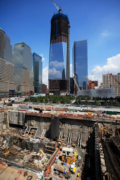 Construction continues on One World Trade Center, top center, and the Vehicle Security Center, lower left, Friday, August 5, 2011 in New York. The tower has reached the 76th floor on the way to 104 floors. (AP Photo/Mark Lennihan)