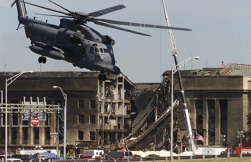 FILE - In this Wednesday, Sept. 12, 2001 file photo, a military helicopter ascends after dropping off personnel at the Pentagon a day after a hijacked airliner crashed into the Department of Defense building in Washington. (AP Photo/Ron Edmonds)