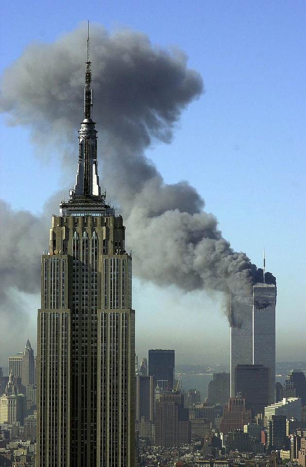 FILE - In this Tuesday, Sept. 11, 2001 file photo, plumes of smoke rise from the World Trade Center buildings in New York. The Empire State building is seen in the foreground. (AP Photo/Patrick Sison)