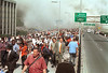 FILE - In this Tuesday, Sept. 11, 2001 file photo, people flee lower Manhattan across the Brooklyn Bridge in New York after a terrorist attack on the World Trade Center. (AP Photo/Daniel Shanken)