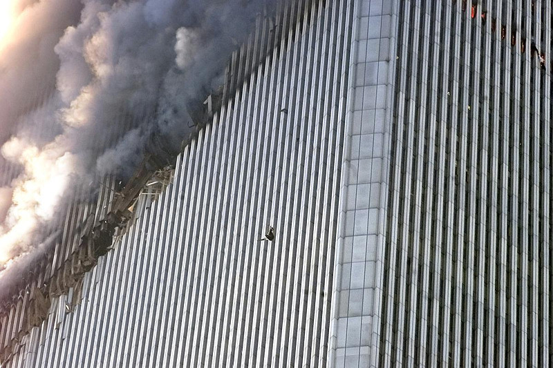 FILE - EDS NOTE GRAPHIC CONTENT - In this Tuesday, Sept. 11, 2001 file photo, a person falls from the north tower of the World Trade Center in New York. (AP Photo/Richard Drew)