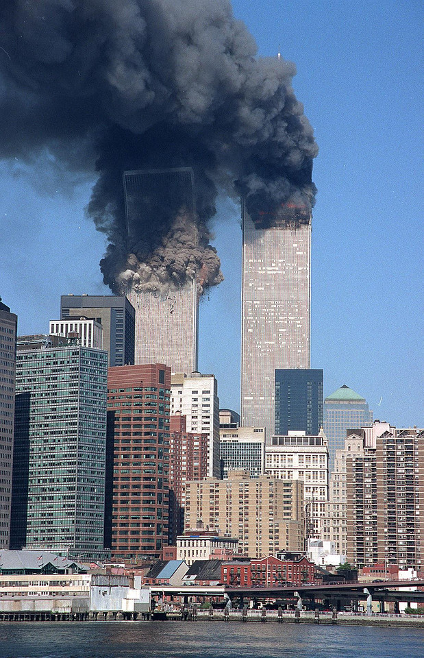 FILE - In this Tuesday, Sept. 11, 2001 file photo, the south tower starts to collapse as smoke billows from both buildings of the World Trade Center in New York. (AP Photo/Jim Collins)