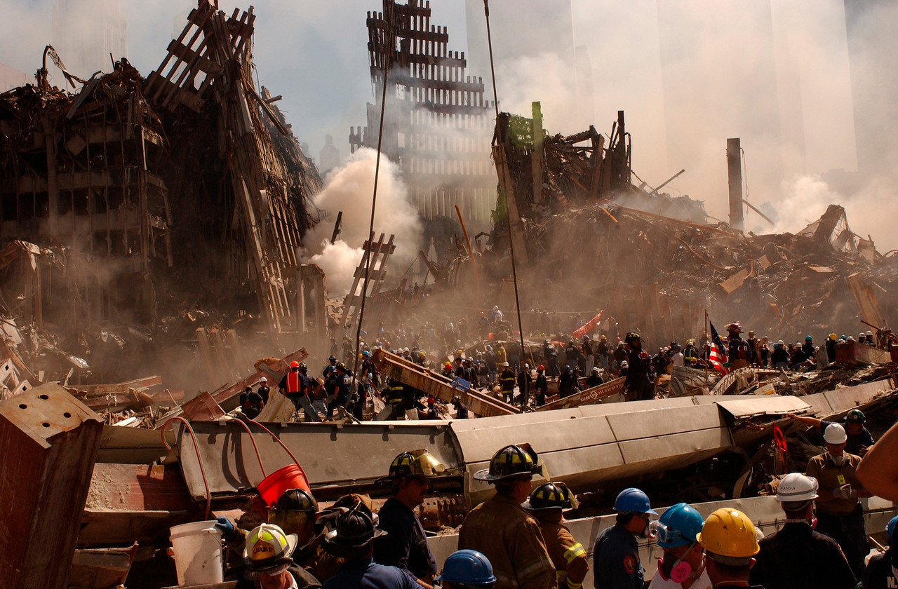 9/13/01  World Trade Center, NY. Members of New York Fire Department and Urban Search and Rescue teams. Andrea Booher/FEMA