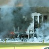 Firefighters work to put out the flames moments after a hijacked jetliner crashed into the Pentagon at approximately 0930 on September 11, 2001.