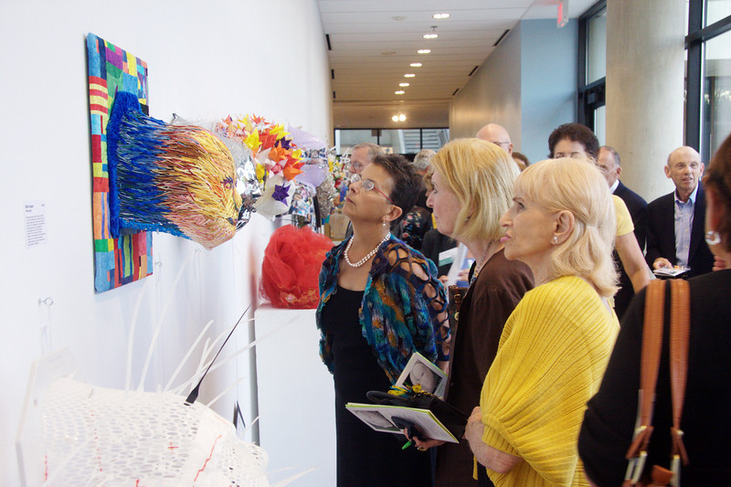 Viewers take it all in -- the art, the cause of helping head and neck cancer patients, and the daunting number of selections on which to bid.