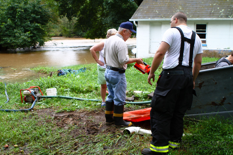 Members of 98 Fire respond to a flooded basement on S Main Street