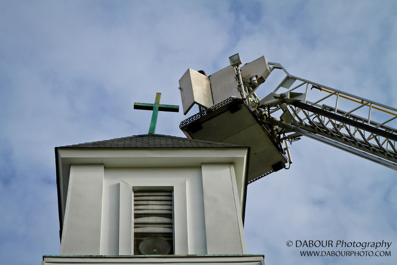 Cross on the Lutheran church needs some assistance