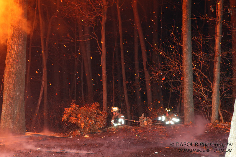 Several members try and engage the fire from driveway right