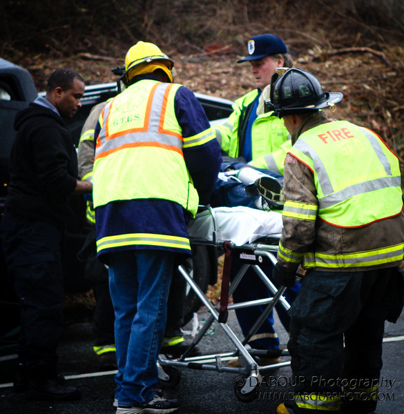 First responders begin to transport one of the drivers to a waiting ambulance from a two vehicle collision on State Route 173 in Greenwich Twp. NJ Saturday morning. Express-Times Photo | DAVE DABOUR