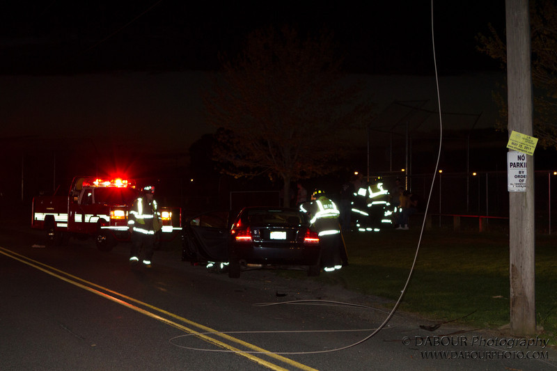 April 17, 2012. Greenwich Twp., NJ – A dark colored Volvo struck a telephone pole on Greenwich Church Road near the ball fields. Three male youths were in the car at the time. Only minor injuries were reported. Power lines were knocked down off of the pole and resulted in a blackout in the local area. JCP&L is on site now. Express-Times Photo | DAVE DABOUR