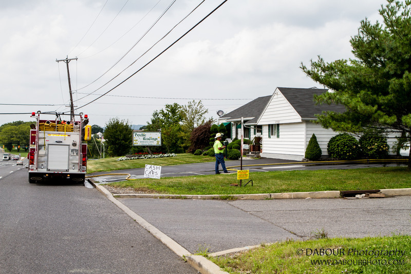 Emergency personnel from the Stewartsville and Pohatcong fire and EMS respond to a car fire in the driveway of Psychic Readings on 22 East in Greenwich Twp on Wednesday afternoon.