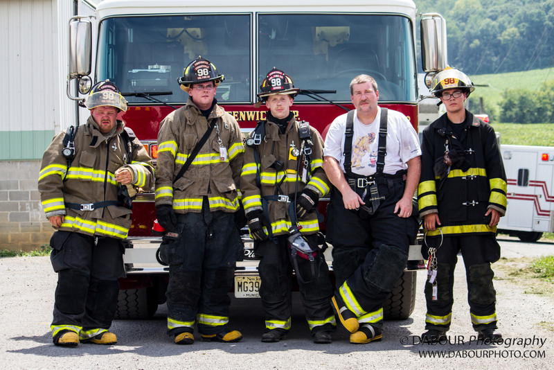 Kyle, Cody, Cody, Phil and Damian of Stewartsville Fire Co. pose for a group shot after responding to a call of a structure fire at Ise Farms in Franklin Twp. Upon arriving they found the fire was out but a hot spot in the externior wall.
